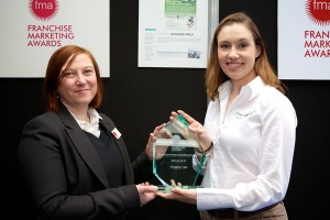 Lisa Suswain receives the award for Best Franchisee Marketing Support